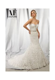 Bridal Gowns By AF Couture featuring 1306 Diamante Beading Edges the Allover Embroidery Design on this Wedding Dress Colors Available: White, Iovry, Candlelight. Sizes Available: 2-28. Available in three lengths: 55', 58', 61'
