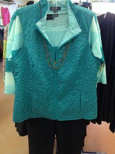 Reversible aqua and sea foam vest with tonal striped sweater.