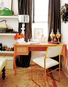 We love the idea of an office cum dressing room. Add a well-dressed writing desk, decorative rug and some open shelving for a custom boutique feel.