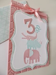 "Birthday card for a little girl that shows the age. I used the elephant, rhino, crocodile and the monkey that holds up the number three from the stamp set ""Zoo Babies"" by Stampin' Up! The cardstock is embossed with a chevron pattern. Follow the link for more detailed pictures: http://crafting-dream.blogspot.com/2015/04/the-zoo-babies-say-hi.html"