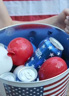 Add frozen water balloons to an outdoor cooler instead of ice for a festive touch! Would be cute with colorful balloons for a kid's birthday party too!