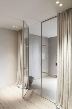 linen panels, slight puddle and hung at ceiling