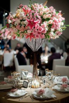 Tall and full pink stargazer lily and spray rose centerpiece.  #weddings  #stargazerlily #pink