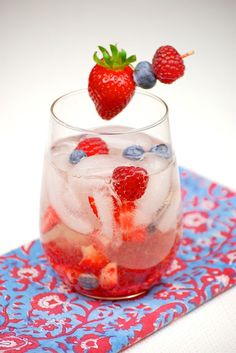Thanks to blueberries, raspberries, and strawberries, white wine sangria gets a patriotic makeover.