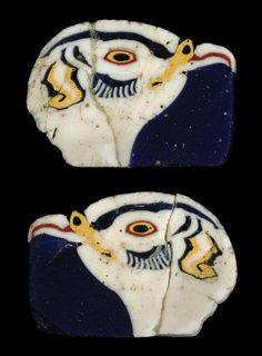 TWO LARGE EGYPTIAN GLASS NILOTIC BIRD HEAD INLAYS   CIRCA 3RD-1ST CENTURY B.C.   Opaque white on a dark blue translucent matrix, finely detailed, opaque red and yellow eyes with translucent blue pupils, opaque yellow and translucent blue facial feathers, mounted  1 1/8 in. (2.8 cm.) wide max.