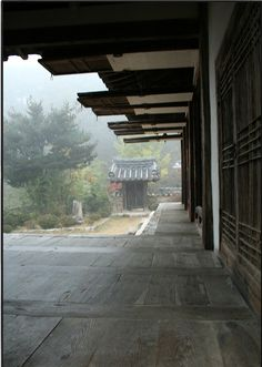 Korean traditional house.  The outer doors are stored against the ceiling but can be swung down for added comfort in winter.