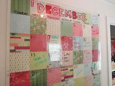 Plexiglass/scrapbook wipe off calendar, I'm making this! Just need to figure out how to hold all of the scrapbook papers together and stick them on the wall....suggestions?