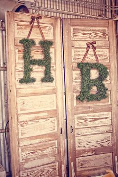 #rustic, #initials, #moss  Photography: Three Nails  Read More: http://www.stylemepretty.com/2011/02/08/vintage-wedding-by-three-nails-photography/