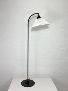 A pair of black Le Klint floor lamps by Flemming Agger Desk Lamp, Table Lamp, Floor Lamps, Lamp Bases, Danish Design, Black Metal, Sconces, Flooring, Etsy