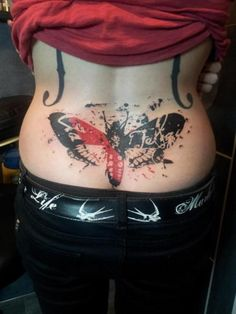 surprisingly I really like the graphic paint splash style of this butterfly tattoo and the two colours. I don't think I'd have it for me, but I really like the graphic style of it.