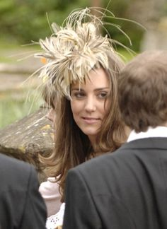At the May 2006 wedding of Laura Parker Bowles and Harry Lopes, Kate amped up the drama with this shades-of-beige feathery fascinator.