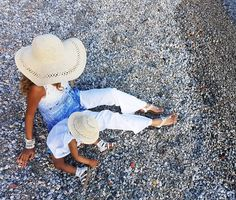 Ohh.. are we shoving hundreds of tiny pebbles into our sandles and down our shirt?  That's great Lils.  Mama's going to have an absolutely wonderful time cleaning that up.  . . . Mama's hat- @hm Lil's hat- @gap_babytec