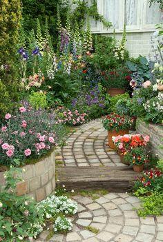 Stone Garden Path with lush flower garden | Plant & Flower Stock Photography: GardenPhotos.com