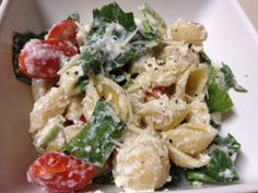 Spinach, cherry tomato, ricotta and garlic pasta salad. I used mostaccioli instead if the shells because that's what I had. Turned pretty good and tasty! And it's light enough for the summer! After you refrigerate it though, the ricotta cheese hardens and it's less creamy..