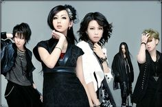 Exist Trace. Hmm, I think I prefer Jyou with wild red hair. Still awesome though no matter what!