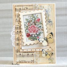 handmade card from love, life and crafts Rudlis ... shabby chic ... collage styel ... rose print framed with die cut postage stamp frame ... layers ... lace and doily ... forget-me-not  printed paper ... sheet music paper ... delightful!