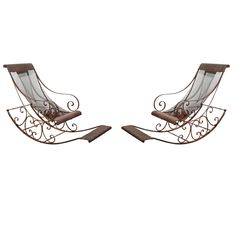 Pair of Outdoor hand forged wrought iron Rocking Chairs.  Aren't they lovely!!