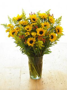 Who can resist a cheery sunflower? Warm Mom's day with these delightful darlings for $50.