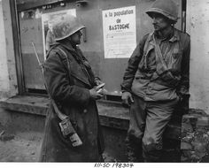 Bastogne Belgium-Weary infantrymen of the 110th Regt. 28th Div. US 1st Army following the German breakthrough in that area. The enemy overran their battalion. (L-R) Pvt. Adam H. Davis and T/S Milford A. Sillars. Dec. 19 1944