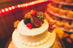 LOVE the fig mixed with berries and flowers as the cake topper.