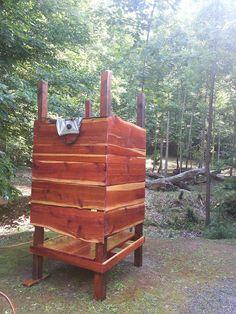 Outdoor cedar shower with solar shower bag. Living off-grid.