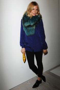 Sienna Miller in an iridescent fur wrap, blue sweater