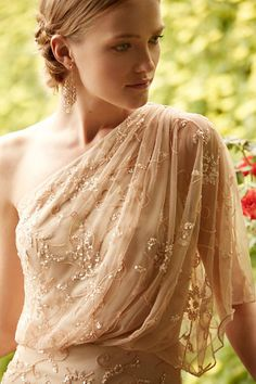 Soft gold hues in delicate tulle and beading, perfect for a glam event..