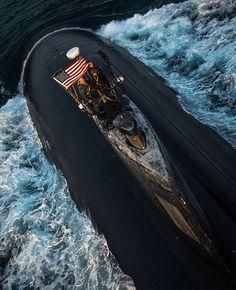 The Los Angeles-class fast attack submarine USS Toledo (SSN 769), transits through the Arabian Gulf.