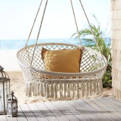 The easy-living leisure of a hammock meets the freewheeling fun of a swing in our unique, handcrafted saucer chair. Its sturdy wrought iron frame is dressed up with white ropes that have been knotted macrame-style to form a laid-back design.