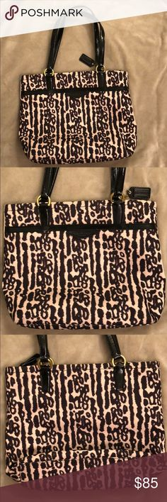 Very Gently Loved Coach Animal Print Tote Bag Very gently loved Coach animal print tote bag.  Bag is dark tan and black with gold handle rings. Great bag for someone who needs more space than a shoulder bag but doesn't need as much room as a full tote bag. Bag features large front pocket, two small inside pockets as well as a medium sized zippered pocket. Coach Bags Totes