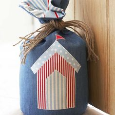Reminisce of fond weekends beside the sea by making this chic costal-inspired doorstop for the home - a simple sewing make that will look great in summer!