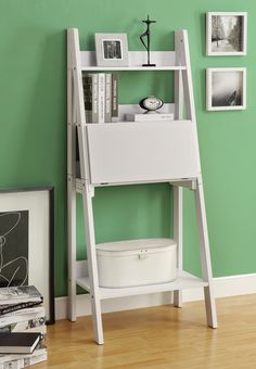 This multifunctional bookcase-desk offers a compact work space that is ideal for apartments, condos, or small homes. With clean lines in a bold white finish, this desk will blend easily with your home décor. The top ladder style shelves can be used to dis Bookcase Desk, Ladder Bookshelf, Wall Bookshelves, Desk Shelves, Bookcase White, Fold Up Desk, Leaning Desk, Leaning Ladder, Drop Down Desk