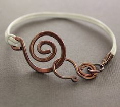White leather copper bracelet with a swirl and swan by IngoDesign