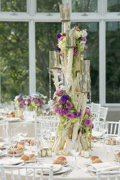 Drift Wood %26 Flower Centerpiece Article: Tall Flower Arrangements to Inspire Your Wedding Centerpieces Photography: Sarah Tew Photography Read More: http://www.insideweddings.com/news/planning-design/tall-flower-arrangements-to-inspire-your-wedding-centerpieces/2484/