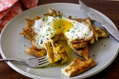 Potato Latke Waffles  Smitten Kitchen  2 large or 4 medium (2 pounds) Russet or baking potato, peeled 1 medium onion (about 6 to 8 ounces), peeled 2 teaspoons baking powder 1 1/2 teaspoons table or fine sea salt Freshly ground black pepper 1/2 cup plus 2 tablespoons all-purpose flour 4 large eggs Nonstick spray, for waffle iron 2 tablespoons fresh chives, finely chopped, for garnish (totally optional)