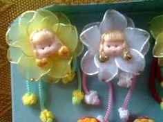 Resultado de imagem para imã de geladeira flor