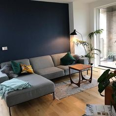 An inspirational image from Farrow and Ball Blue Feature Wall, Blue Living Room Color, Blue Feature Wall Living Room, Snug Room, Contemporary Lounge, Blue Living Room Decor, Living Room Wall Color, Cosy Living Room, Blue Walls Living Room