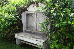 interesting shape to this garden bench- makes me think of a wing back settee I had.