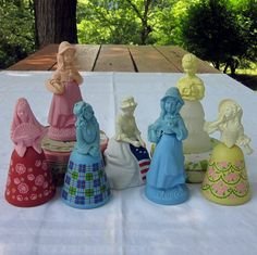 Vintage Avon Collectibles -still have the one in back on right - yellow top holding flowers w/ frosted dress