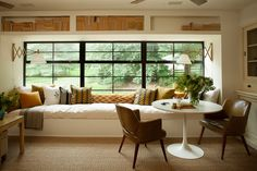 House Tour:  Lauren Liess In love with this creative use of space - large window seat with a bookcase above, with small dining table / card table with leather antique chairs. Wonderful neutral textures and mix of modern and bohemian vibes.