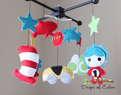 """Baby Crib Mobile - Baby Mobile - Dr. Seuss Mobile """"Inspired by Dr. Seuss Story Books"""" Cat in the Hat, Green Eggs and Ham, Thing and more.. $95.00, via Etsy."""