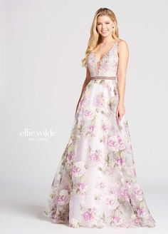 78db38380d Ellie Wilde for Mon Cheri is a sleeveless sheer plunging V-neck Prom gown in  Metallic Lace, floral Printed Burnout Organza, and Allover Lace, with a  sheer V ...