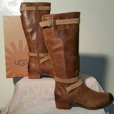 BNWT.. UGG TALL Brown/Tan strappy boots BNWT.. UGG TALL Brown/Tan strappy boots. These are brand new-never worn. They are more of a structured boot. The leather is thicker, very durable and they are Absolutely beautiful! UGG Shoes
