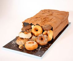 This is a cake- that looks like a paper bag... full of dounuts. Piece of art!!!