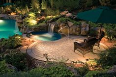 The outdoor living design around this pool includes 'outdoor rooms.' One outdoor room is a situated around the hot tub and a second is at the far end with a comfy loveseat. The outdoor living space is completed with landscape lighting and elegant landsc Swimming Pool Waterfall, Swimming Pool Decks, Backyard Pool Landscaping, Landscaping Ideas, Backyard Ideas, Patio Ideas, Tropical Landscaping, Outdoor Ideas, Garden Ideas