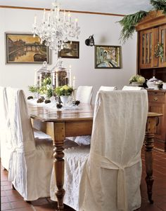 Apothecary jars filled with pinecones make a naturally striking centerpiece.   - CountryLiving.com