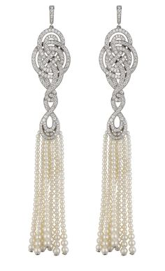 Garrard earrings from the Entanglement collection with diamonds and pearl tassels, set in gold.
