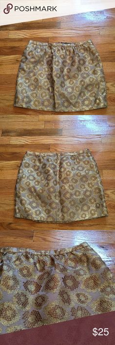 J.Crew Gold & Bronze Skirt A jcrew skirt in excellent condition. A back zip feature and is also lined underneath. It features a bronze and gold circular pattern. J. Crew Skirts Mini