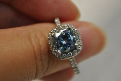 Gorgeous blue diamond ring with white diamond halo. #engagementrings  #fancycolordiamonds  #bluediamonds