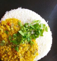Masoor Dal/Pink Lentils cooked with Spinach and served with rice is a perfect and complete meal on a weekend!